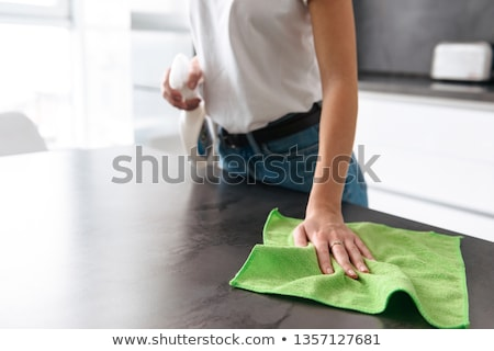 Close-up of a woman cleaning a kitchen at home