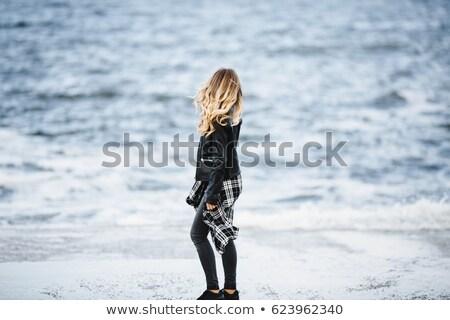 Szép fiatal nő fekete macskanadrág kézitáska nő Stock fotó © acidgrey