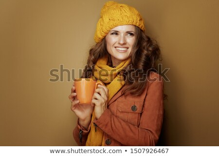 A cute middle age woman with a leather jacket. Stock photo © photography33