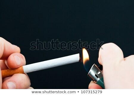 Alguien iluminación cigarrillo blanco fuego humo Foto stock © wavebreak_media