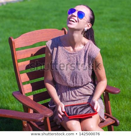 小さな 幸せ ブルネット 椅子 屋外 後ろ ストックフォト © travnikovstudio