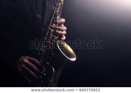 saxophonist on a black background Stock photo © isaxar