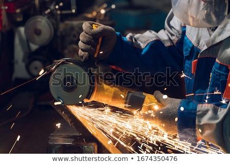 Stock photo: Man Working With Circular Saw Blade