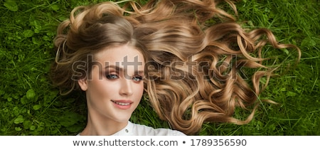 beautiful lady with green grass hairstyle stock photo © shawlinmohd