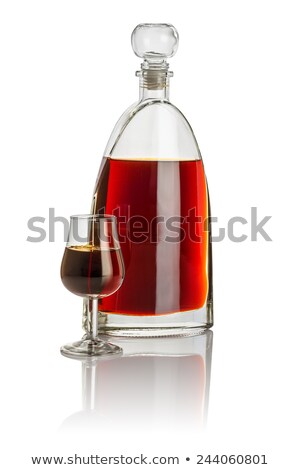 Carafe and snifter filled with brown liquid Stock photo © Zerbor