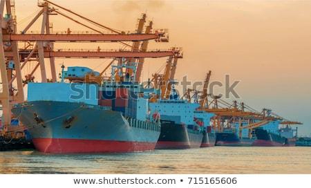 Stockfoto: Container Cargo Freight Ship With Working Crane Bridge