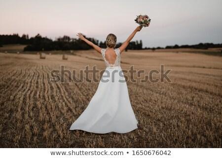 Menyasszony átjáró virágcsokor esküvő arc szeretet Stock fotó © Paha_L