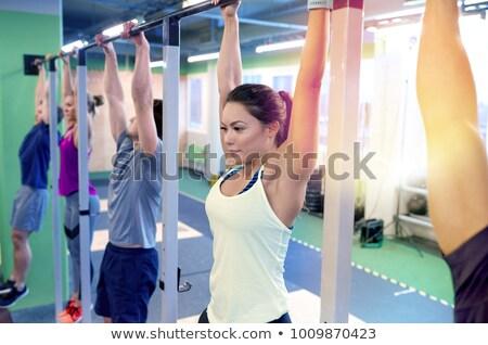 girl hanging on horizontal bar stock photo © ruslanomega