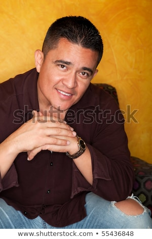 Mexican man with smile on chair Stock photo © ozgur