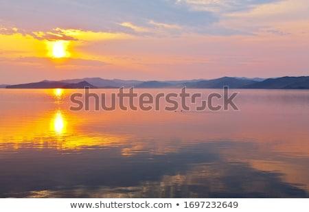 Gyönyörű égbolt felhők kora reggel napfelkelte madarak Stock fotó © meinzahn