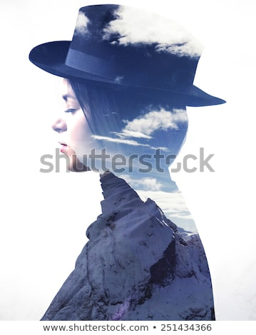 Attractive girl with a hat double exposure Stock photo © zurijeta