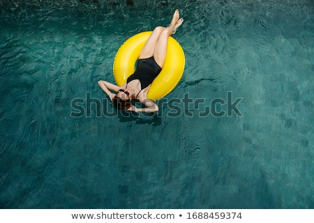Model in swimsuit lies on rubber ring Stock photo © bezikus