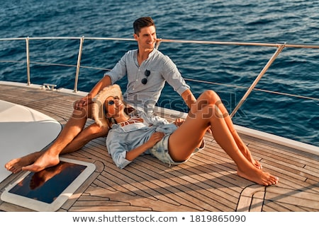 Couple sitting and having fun together on yacht Stock photo © deandrobot