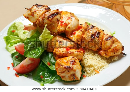 Couscous with vegetables and chicken skewer Stock photo © Peteer
