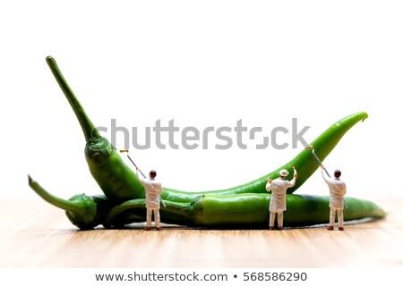 Miniature painters coloring green chilli peppers. Macro photo Stock photo © Kirill_M