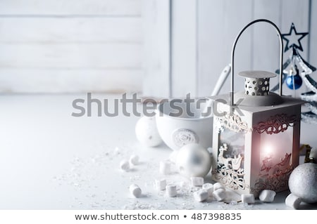 Lantern and candles over white wooden background. Copy space. Stock photo © Yatsenko