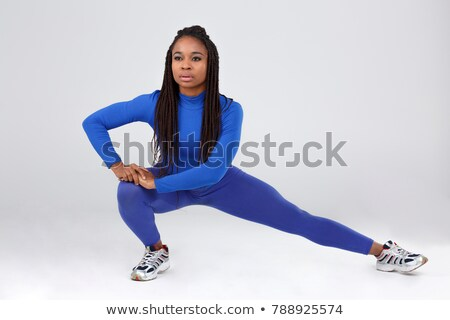 attractive young fitness lady make stretching exercises stock photo © deandrobot