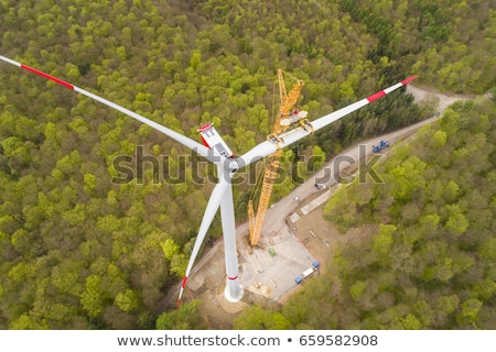 wind turbines under cloud sky stock photo © ssuaphoto