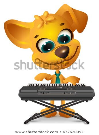 Yellow dog is playing synthesizer Stock photo © orensila