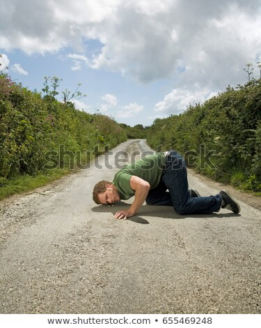 Man With Ear Pressed to Road Surface Stock photo © IS2