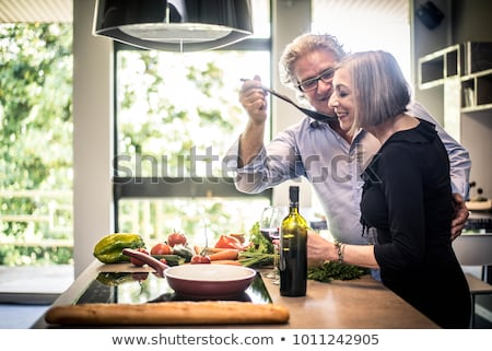 idős · pár · iszik · vörösbor · ünnepel · üveg · ital - stock fotó © is2
