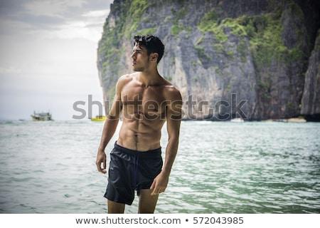 若い男 水着 草 男 笑みを浮かべて 休暇 ストックフォト © IS2