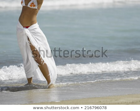 Mid section of woman in bikini standing on beach Stock photo © wavebreak_media