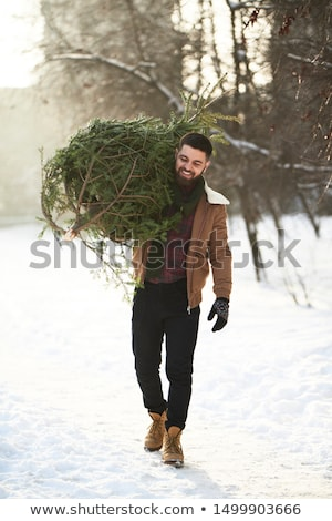 Portrait of a happy bearded man dressed in coat Stock photo © deandrobot