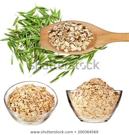 Oat in wooden bowl and spoon. Groats in wood dish and shovel. Gr Stock photo © MaryValery