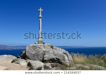 cross in finisterre end of saint james way in spain stock photo © lunamarina