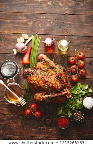 Roasted whole chicken or turkey served with chilli pepers and chive Stock photo © dash