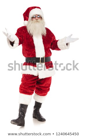 santa claus steps forward and makes greeting gesture Stock photo © feedough