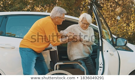 Man Helping Disabled Wife To Get Out Of A Car Stock photo © AndreyPopov