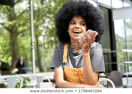 Cabelos cacheados menina adolescente telefone móvel janela casa menina Foto stock © boggy