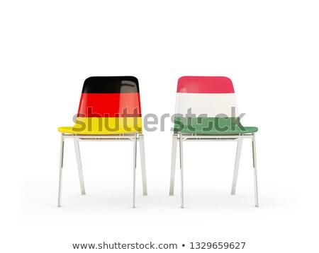 Deux chaises drapeaux Allemagne Hongrie isolé Photo stock © MikhailMishchenko