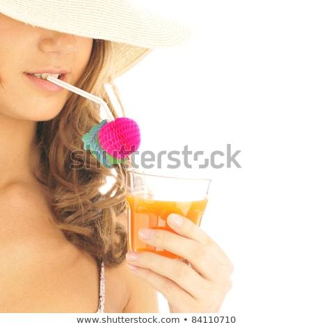 encantador · mulher · potável · suco · de · laranja · sorridente · câmera - foto stock © deandrobot