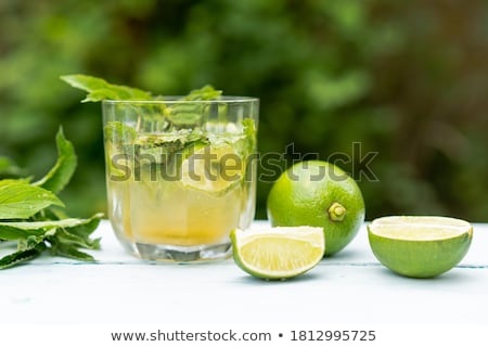 Stockfoto: Holidays and drink concept. Cold cocktail, lemonade with lemon