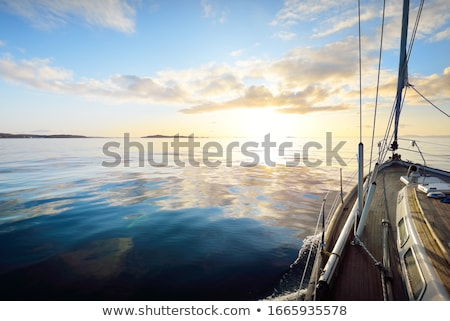 sunset at sea with a yacht stock photo © biv