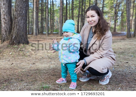 portrait of a happy young girl outdoors forest with babysitter stock photo © lopolo