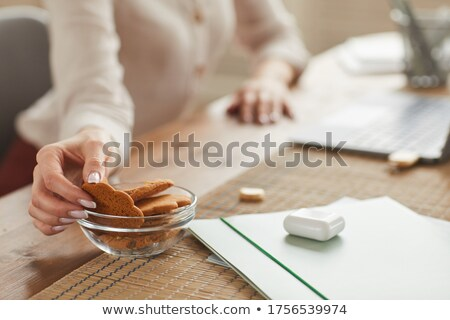 close up of unrecognizable woman sitting at table and drinking coffee stock photo © pressmaster