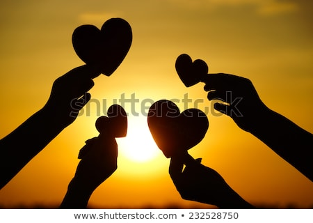 men hands holding hearts silhouette on Silhouette sunset Stock photo © Lopolo