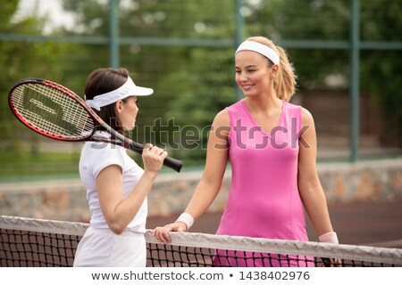 Blonde and brunette young women interacting by net Stock photo © pressmaster