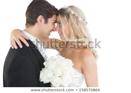 Bride and Bridegroom hugging each other at wedding Stock photo © Kzenon