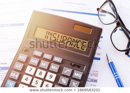 A calculator with the word Insurance on the display Stock photo © Zerbor
