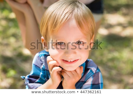 portrait of cute little boy child outdoors on the nature stock photo © lopolo