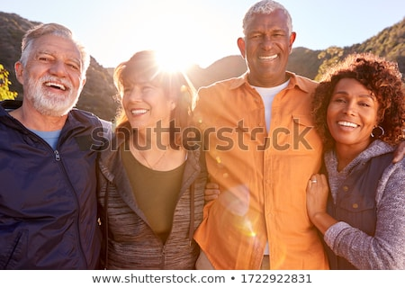 Stock photo: Front view of group of active senior women smiling and looking at photo album at nursing home