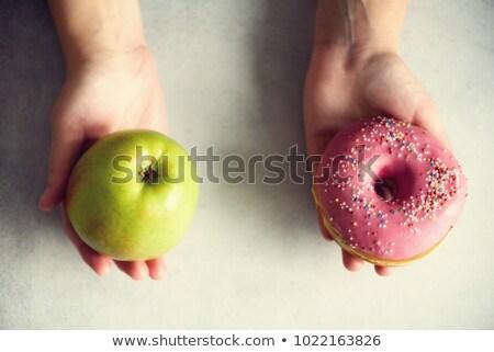 Vrouw kiezen appel donut snack triest Stockfoto © HighwayStarz