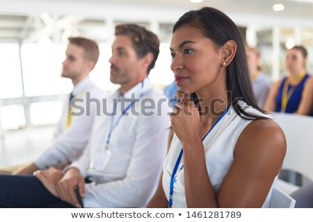 Side view of diverse well dressed business people attending a business seminar in office building Stock photo © wavebreak_media