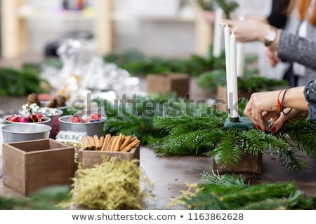 Close-up of Christmas decorations with decorative flowers and gifts in a box lying on a sofa Stock photo © ElenaBatkova