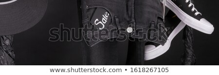 Banner with Sale sign, Black and white snaekers, cap and pant, jeans Stock photo © Illia